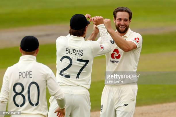 England's Chris Woakes celebrates with teammates after taking the wicket of Pakistan's Mohammad Rizwan for 9 during play on the second day of the...