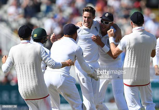 England's Chris Woakes celebrates with teammates after taking the wicket of Pakistan's Asad Shafiq during play on the final day of the third test...