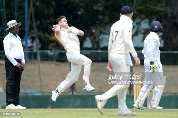 England's Chris Woakes delivers the ball during the second day of a fourday practice match between Sri Lanka Board President's XI and England at the...