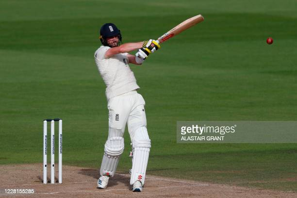 England's Chris Woakes hits a shot on the second day of the third Test cricket match between England and Pakistan at the Ageas Bowl in Southampton,...