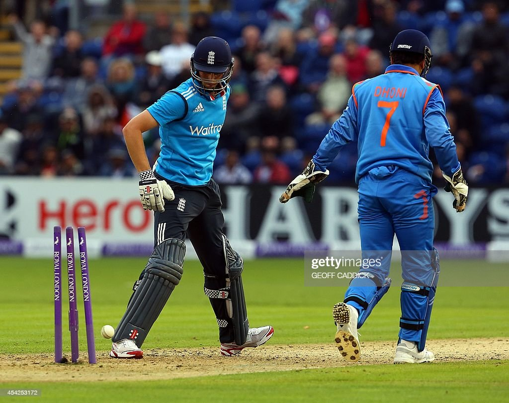 England's Chris Woakes (L) is stumped by India's wicket keeper Mahendra Singh Dhoni (R) during the second one-day international cricket match between England and India at the Glamorgan County Cricket Ground in Cardiff, Wales on August 27, 2014. India won by 133 runs.