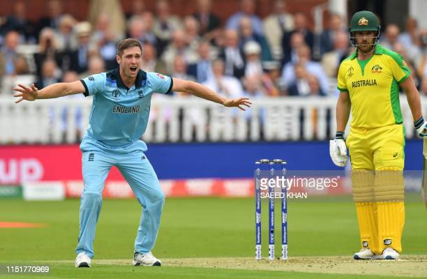 England's Chris Woakes makes an appeal for a leg before wicket decision against Australia's captain Aaron Finch during the 2019 Cricket World Cup...
