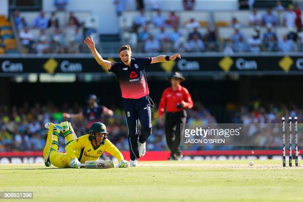 England's Chris Woakes runs out Australia's Alex Carey during the 2nd oneday international cricket match between England and Australia in Brisbane on...