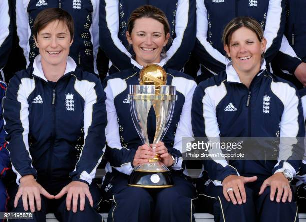 England's Claire Taylor captain Charlotte Edwards and Nicky Shaw with the ICC Women's World Cup trophy at Lord's Cricket Ground London 24th March...
