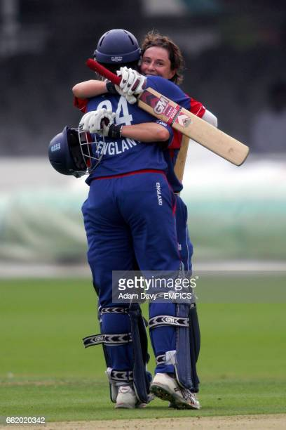 England's Claire Taylor celebrates her centuary with team mate Jenny Gunn