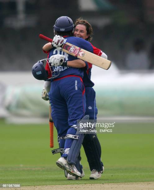 England's Claire Taylor is congratulated by teammate Jenny Gunn on her 150 runs