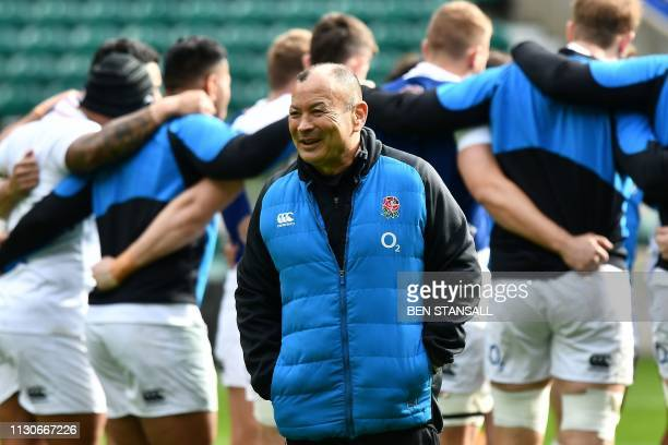 England's coach Eddie Jones attends the captain's run training session at Twickenham stadium in south west London on March 15 on the eve of their Six...