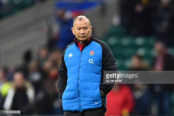 England's coach Eddie Jones checks out the pitch conditions ahead of the Six Nations international rugby union match between England and Scotland at...