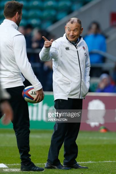 England's coach Eddie Jones jokes with his staff before kick off of the international rugby union test match between England and Japan at Twickenham...