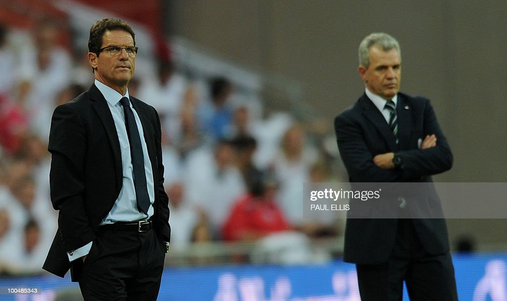 England's coach Fabio Capello (L) and Mexico's coach Javier Aguirre watch their teams during their international friendly football match against at Wembley Stadium in London on May 24, 2010 AFP PHOTO/Paul Ellis
