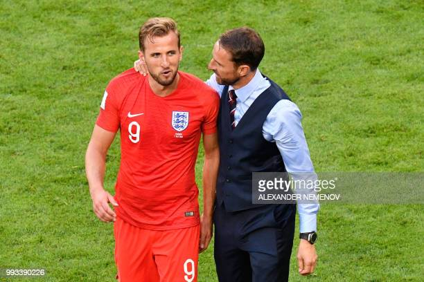 TOPSHOT England's coach Gareth Southgate and England's forward Harry Kane celebrate after winning during the Russia 2018 World Cup quarterfinal...