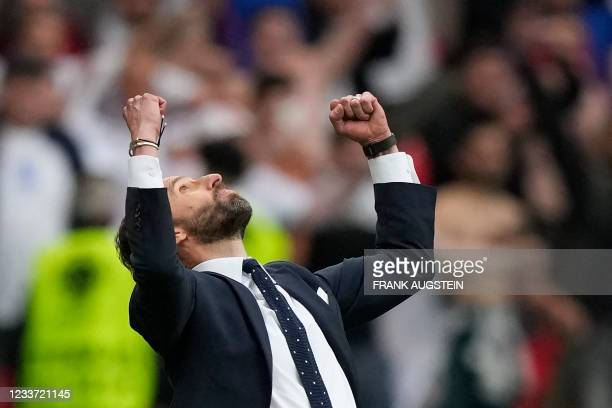 England's coach Gareth Southgate celebrates his team's victory at the end of the UEFA EURO 2020 round of 16 football match between England and...