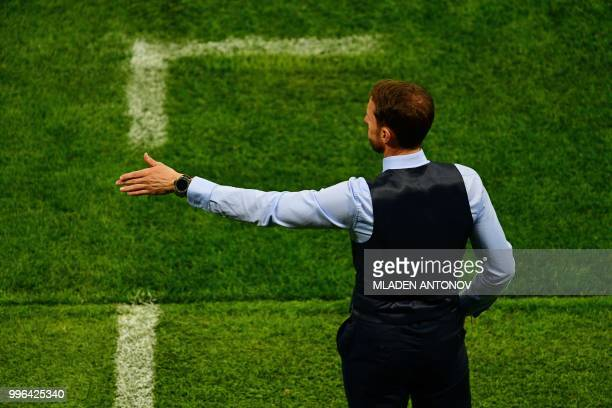 England's coach Gareth Southgate gestures during the Russia 2018 World Cup semifinal football match between Croatia and England at the Luzhniki...