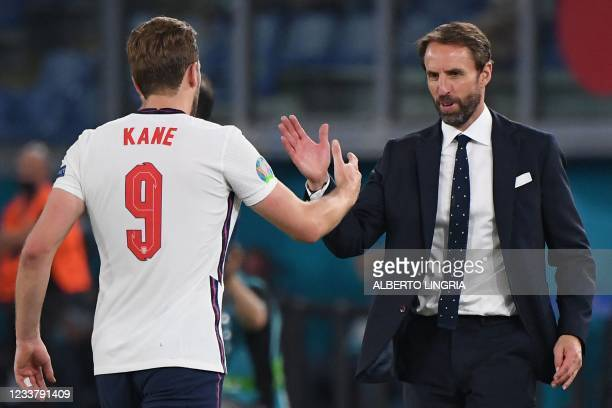 England's coach Gareth Southgate greets England's forward Harry Kane after being substituted during the UEFA EURO 2020 quarter-final football match...