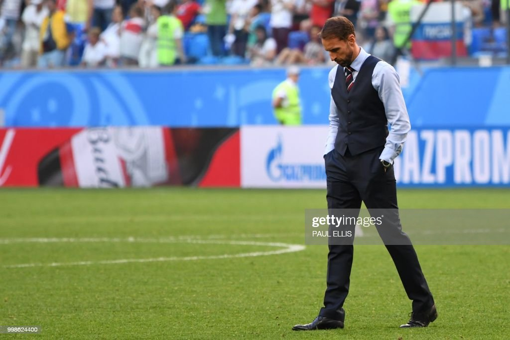 England's coach Gareth Southgate reacts after his team lost the Russia 2018 World Cup play-off for third place football match between Belgium and England at the Saint Petersburg Stadium in Saint Petersburg on July 14, 2018. (Photo by Paul ELLIS / AFP) / RESTRICTED