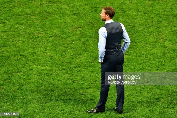 England's coach Gareth Southgate reacts after losing the Russia 2018 World Cup semifinal football match between Croatia and England at the Luzhniki...
