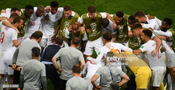 TOPSHOT England's coach Gareth Southgate speaks to his players before extra time during the Russia 2018 World Cup semifinal football match between...
