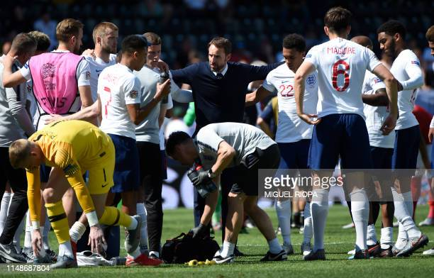 England's coach Gareth Southgate speaks to his players prior to playing the extratime during the UEFA Nations League third place playoff football...