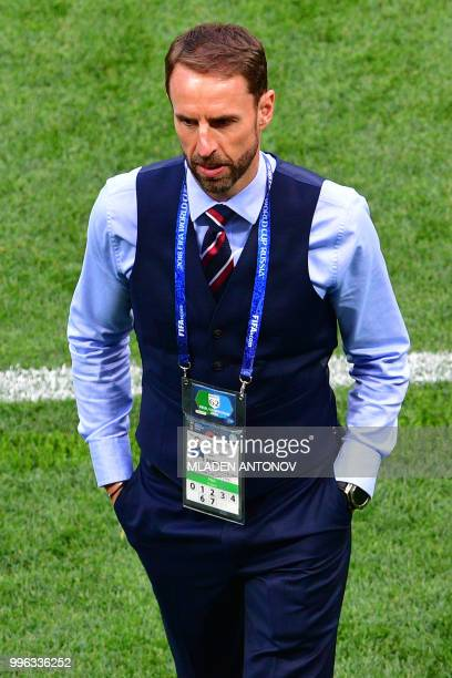 England's coach Gareth Southgate walks on the pitch prior the Russia 2018 World Cup semifinal football match between Croatia and England at the...