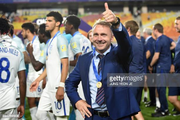 England's coach Paul Simpson celebrates winning the U20 World Cup final football match between England and Venezuela in Suwon on June 11 2017 / AFP...