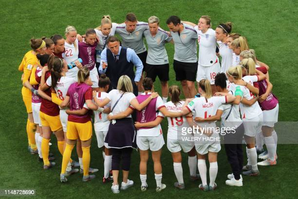 TOPSHOT England's coach Phil Neville speaks to his players after they won the France 2019 Women's World Cup Group D football match between England...