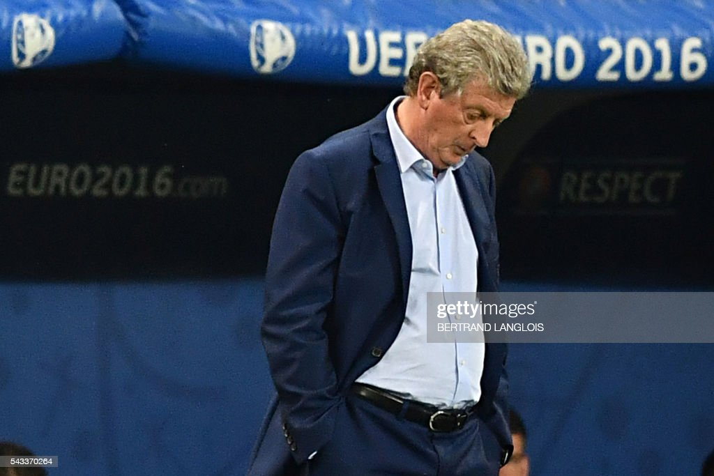 TOPSHOT - England's coach Roy Hodgson reacts during the Euro 2016 round of 16 football match between England and Iceland at the Allianz Riviera stadium in Nice on June 27, 2016. /