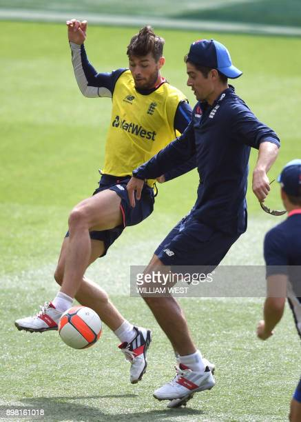 England's cricket players Ben Foakes and Alastair Cook fight for the ball during training at the MCG in Melbourne on December 25 2017 Australia play...