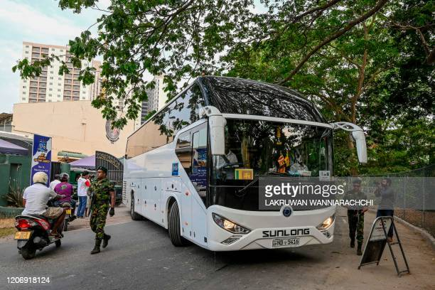 England's cricket team bus leaves the ground after the Test series against Sri Lanka was postponed at the P Sara Oval Cricket Stadium in Colombo on...