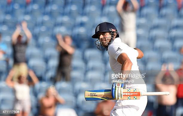 England's cricket team captain Alastair Cook celebrates taking a run to defeat West Indies during the final day of the second Test cricket match...