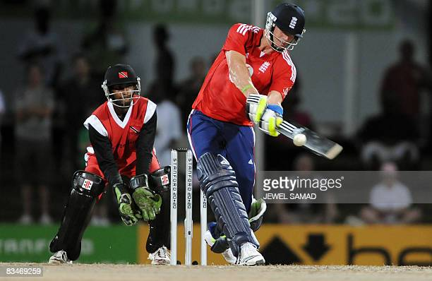 "England's cricket team captain Kevin Pietersen ""switch"" hits the ball off Trinidad and Tobago's bowler Sherwin Ganga as wicketkeeper Denesh Ramdin..."