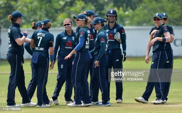 England's cricketer Alex Hartley celebrates with teammates after dismissing Sri Lanka's cricketer Anushka Sanjeewani during the third one day...
