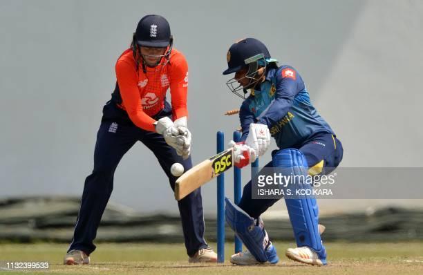 England's cricketer Amy Jones celebrates after dismissing Sri Lanka's cricketer Shashikala Siriwardene during the first T20 international cricket...