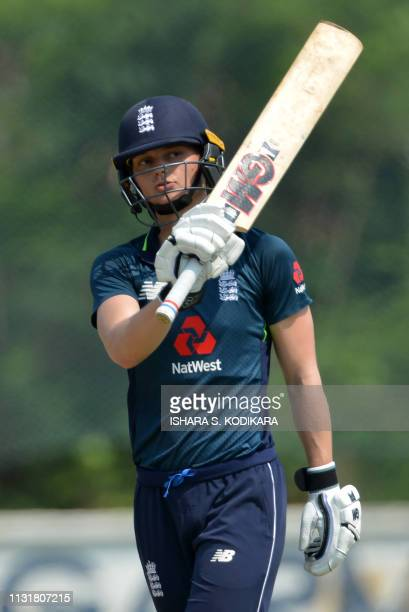 England's cricketer Amy Jones celebrates her half century during the third one day international cricket match between Sri Lanka and England at the...