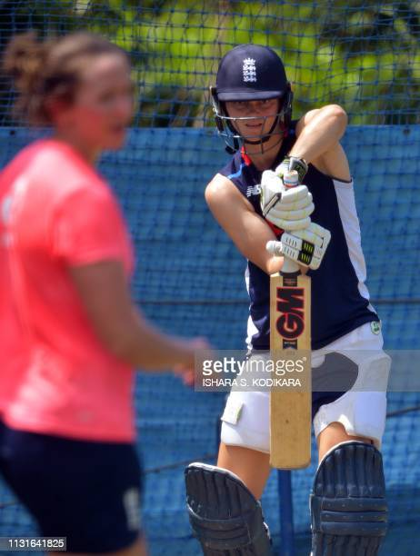 England's cricketer Amy Jones plays a shot during a practice session at the Chilaw Marians Grounds in Katunayake on March 20 ahead of the 3rd oneday...