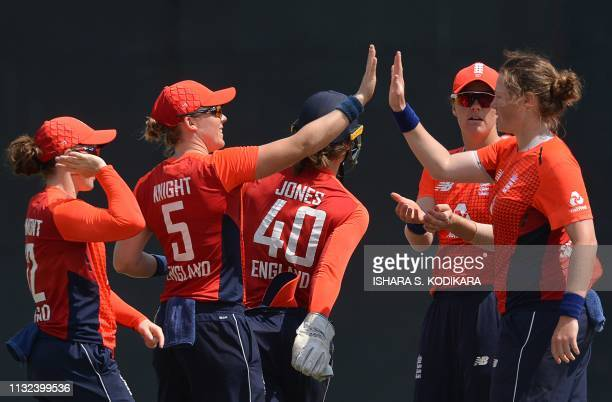 England's cricketer Anya Shrubsole celebrates after dismissing Sri Lanka's cricketer Chamari Atapattu during the first T20 international cricket...