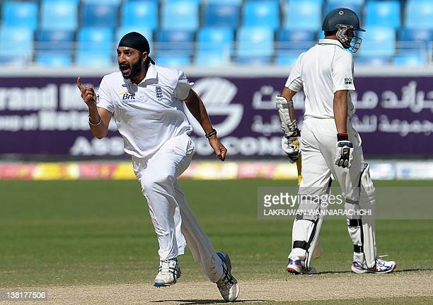 England's cricketer Monty Panesar celebrates after he dismissed Pakistan's Mohammad Hafeez during the second day of the third and final Test match...