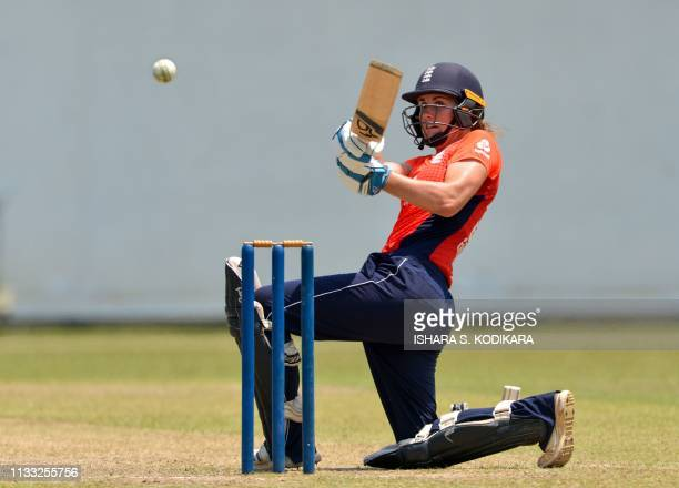 TOPSHOT England's cricketer Natalie Sciver plays a shot during the third Twenty20 international cricket match between Sri Lanka and England at the P...