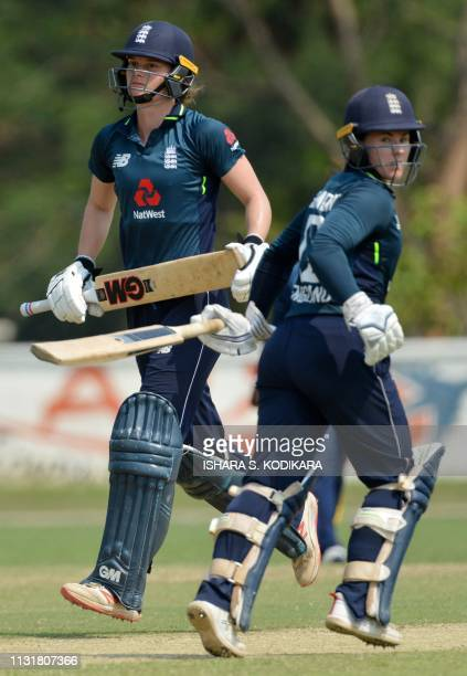 England's cricketer Tammy Beaumont and Amy Jones run between the wickets during the third one day international cricket match between Sri Lanka and...