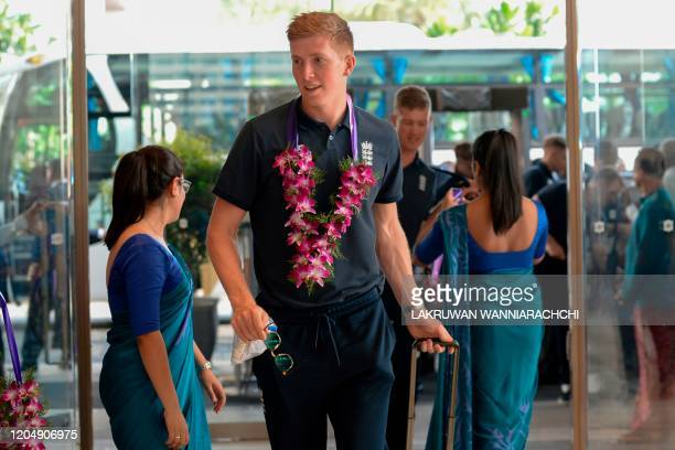 England's cricketer Zak Crawley arrives with England's cricket team for their tour of Sri Lanka at a hotel in Colombo on March 3 2020 England will...