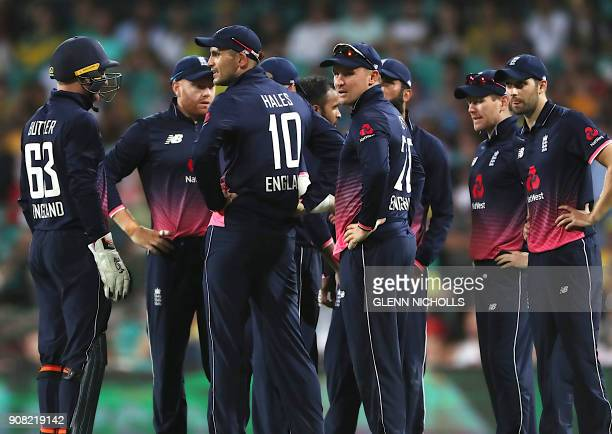 England's cricketers celebrate with teammate Alex Hales after he caught out Australia's Mitchell Marsh during the third oneday international cricket...