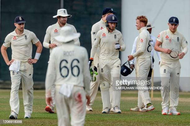 England's cricketers leave the ground after the second day of a four-day practice match between Sri Lanka Board President's XI and England at the P....