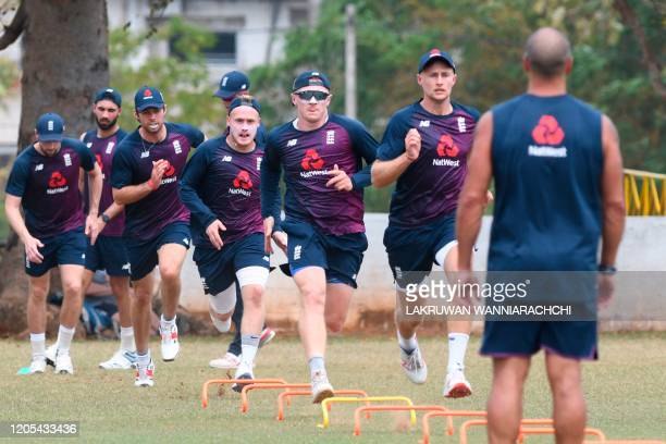 England's cricketers warm up during a practice session at the Marians Cricket Club Ground in Katunayake on March 6 2020 England will play two test...