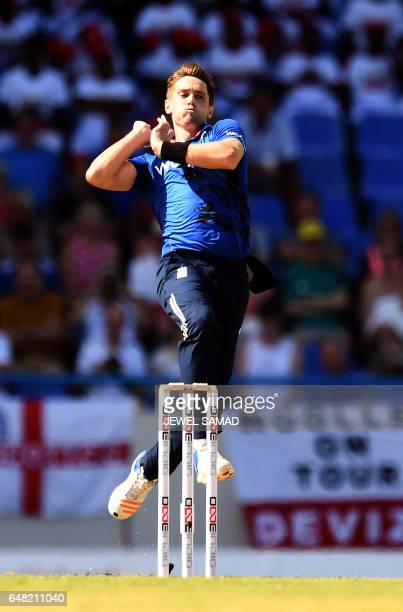 England's crickter Chris Woakes delivers a ball during the second of the threematch One Day International series between England and West Indies at...