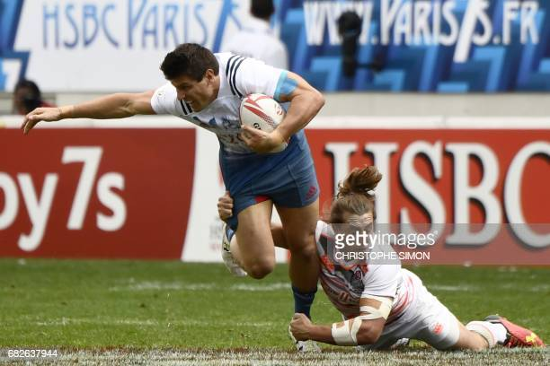 England's Dan Bibby tackles France's Jeremy Aicardi during their Rugby 7 tournament rugby match England vs France at the Jean Bouin Stadium in Paris...