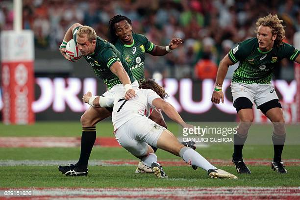 England's Dan Bibby tackles South Africa's captain Philip Snyman during the World Sevens Cape Town leg rugby match on December 11 2016 at the Cape...