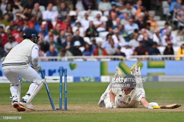 England's Dan Lawrence makes his ground to avoid a run out on the fourth day of the first cricket Test match of the India Tour of England 2021...