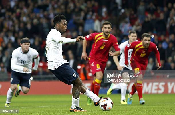 England's Daniel Sturridge scores the fourth goal from the penalty spot during the World Cup 2014 Group H Qualifying football match between England...