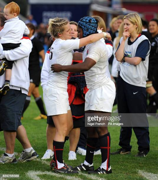 England's Danielle Waterman and Maggie Alphonsi console each other after defeat to New Zealand during the Final at Twickenham Stoop in London