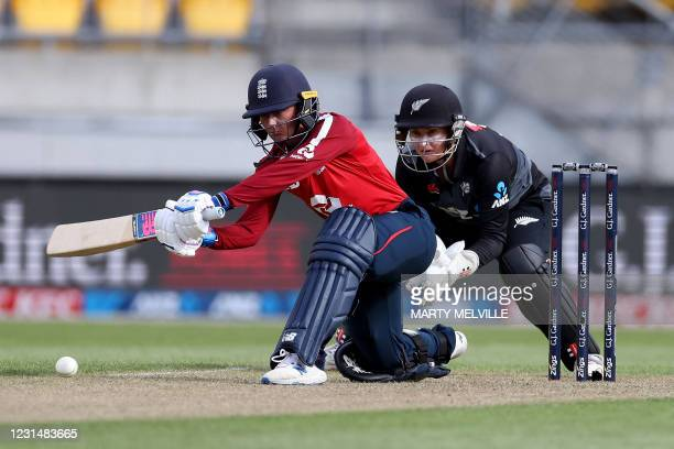 England's Danni Wyatt plays a shot with New Zealand's wicketkeeper Katey Martin during the third women's Twenty20 cricket match between New Zealand...
