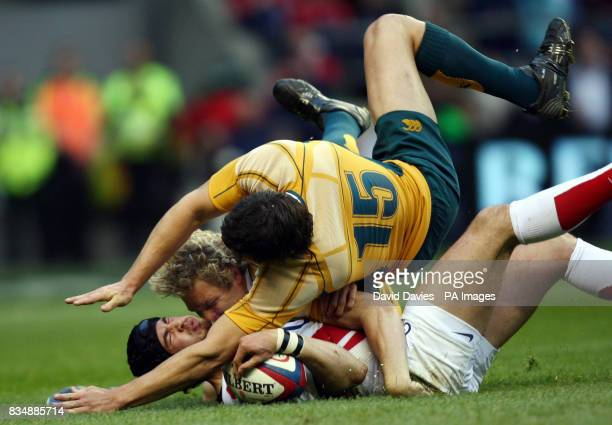 England's Danny Cipriani is brought down by Australia's Peter Hynes and Adam AshleyCooper during the International match at Twickenham London